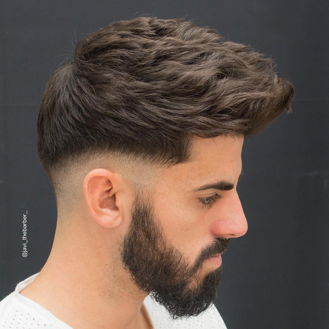 Textured haircut for thick hair and low bald fade